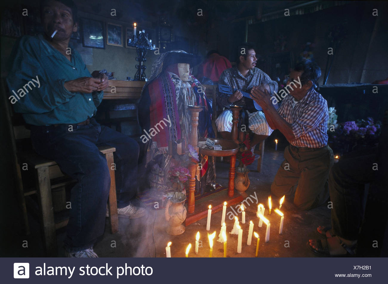 Guatemala, Santiago Atitlan, men, prayer, ceremony men, religion, recite, prayer, skyers, blast, man, guitar, donation, Culte A Maximon, tradition, faith, culture, - Stock Image