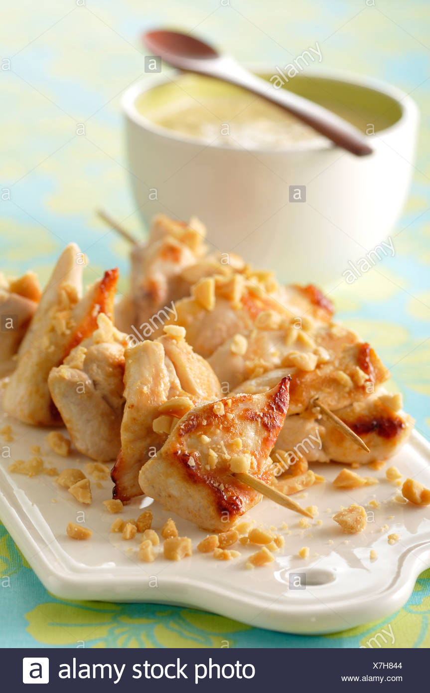 Chicken brochettes with peanut sauce - Stock Image