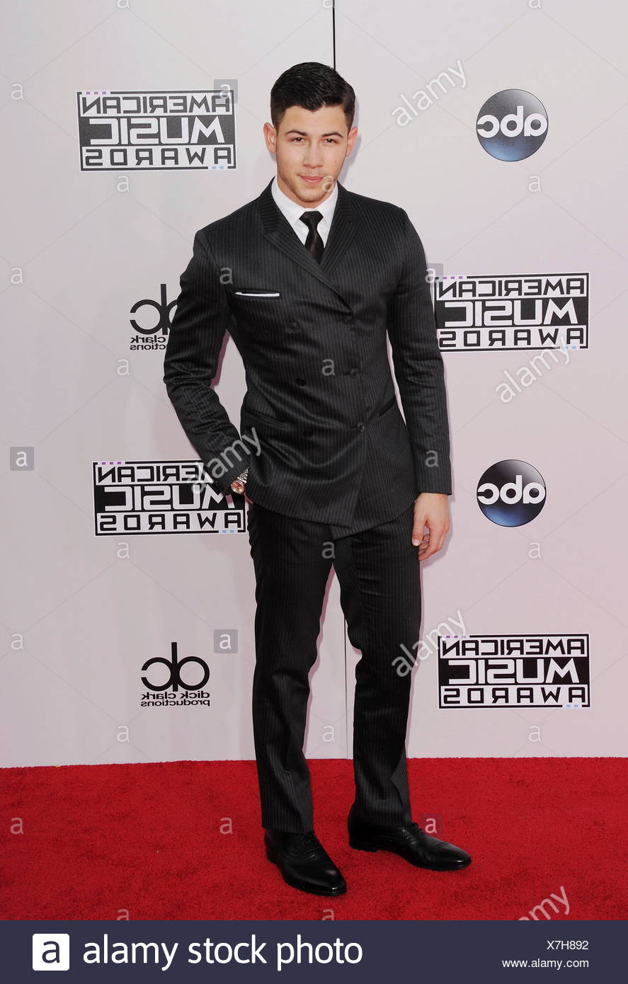 Recording artist Joe Jonas arrives at the 2014 American Music Awards at Nokia Theatre L.A. Live on November 23, 2014 in Los Angeles, California., Additional-Rights-Clearances-NA Stock Photo