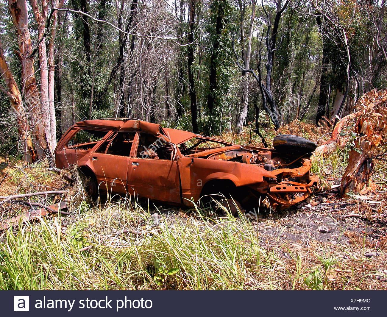wreck scrap vehicle rust Stolen assurance insurance vandalism scrap metal car automobile - Stock Image