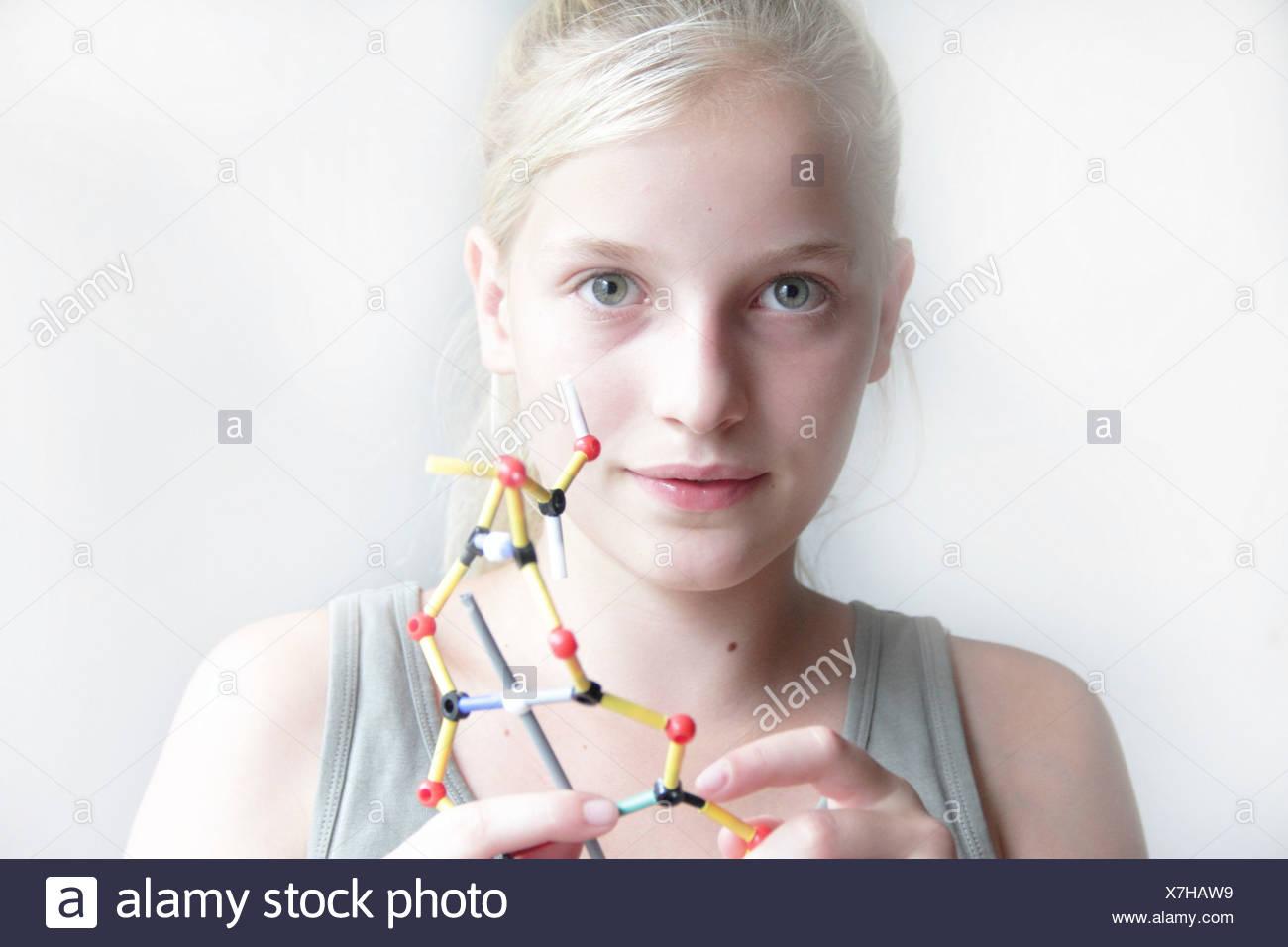 Girl constructing a molecular model - Stock Image