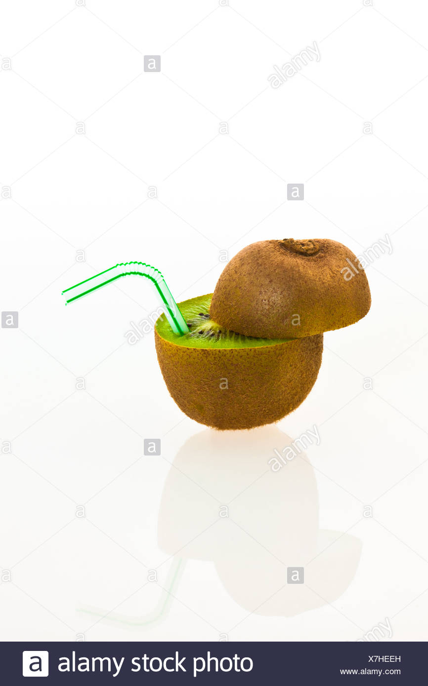 Kiwi fruit with a drinking straw as a soft drink - Stock Image