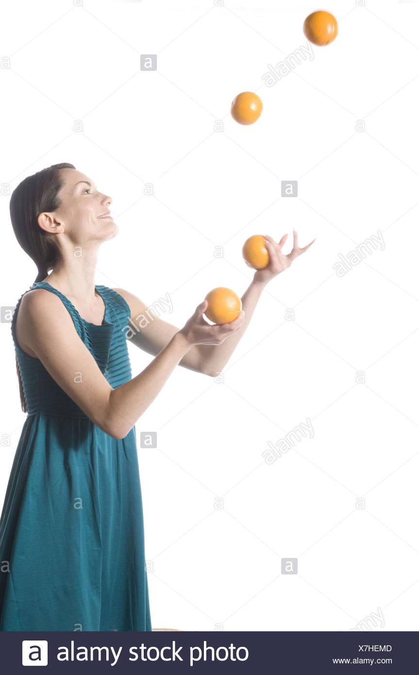 Woman, oranges, juggle, - Stock Image