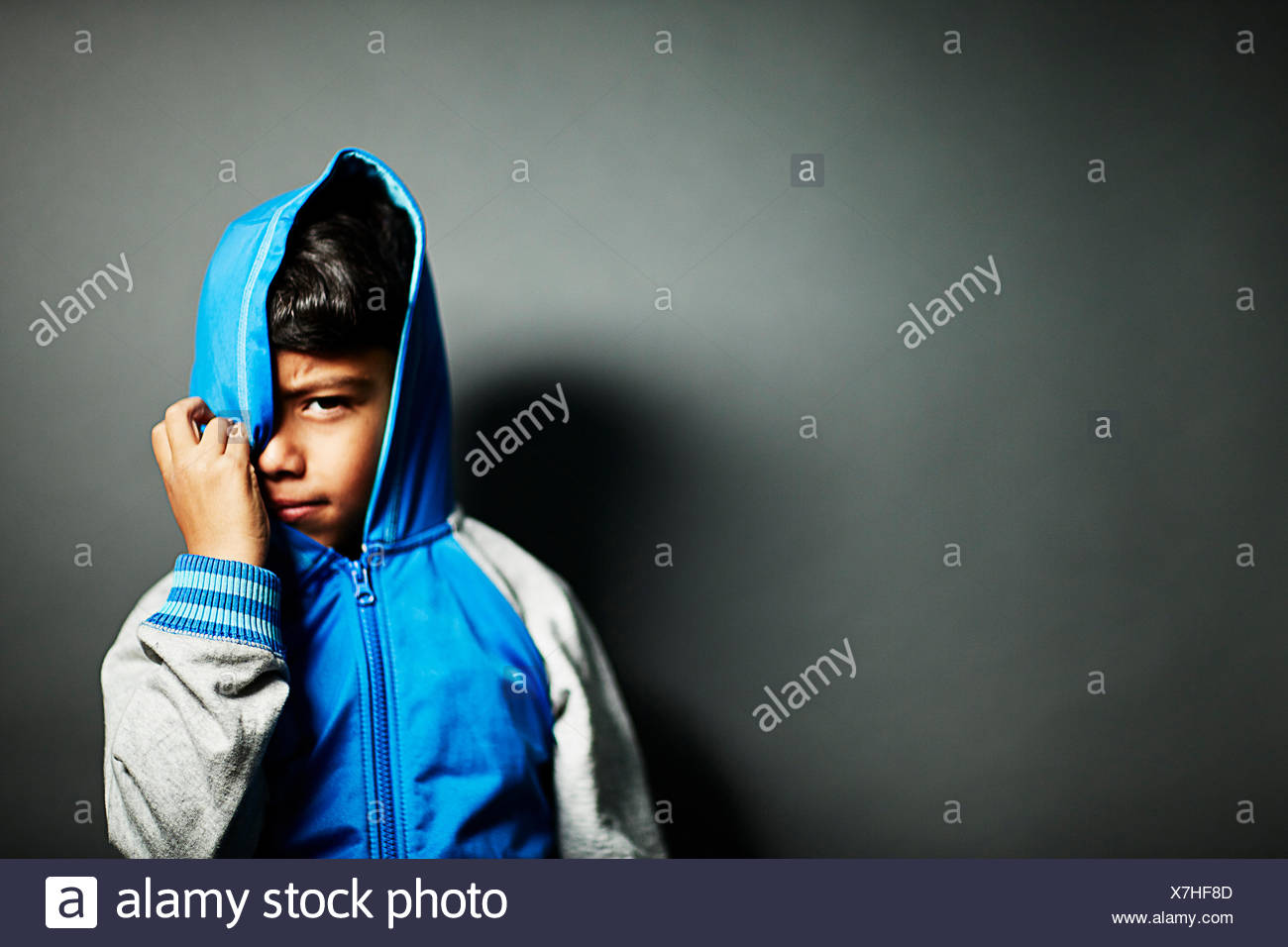 Boy wearing hooded top - Stock Image