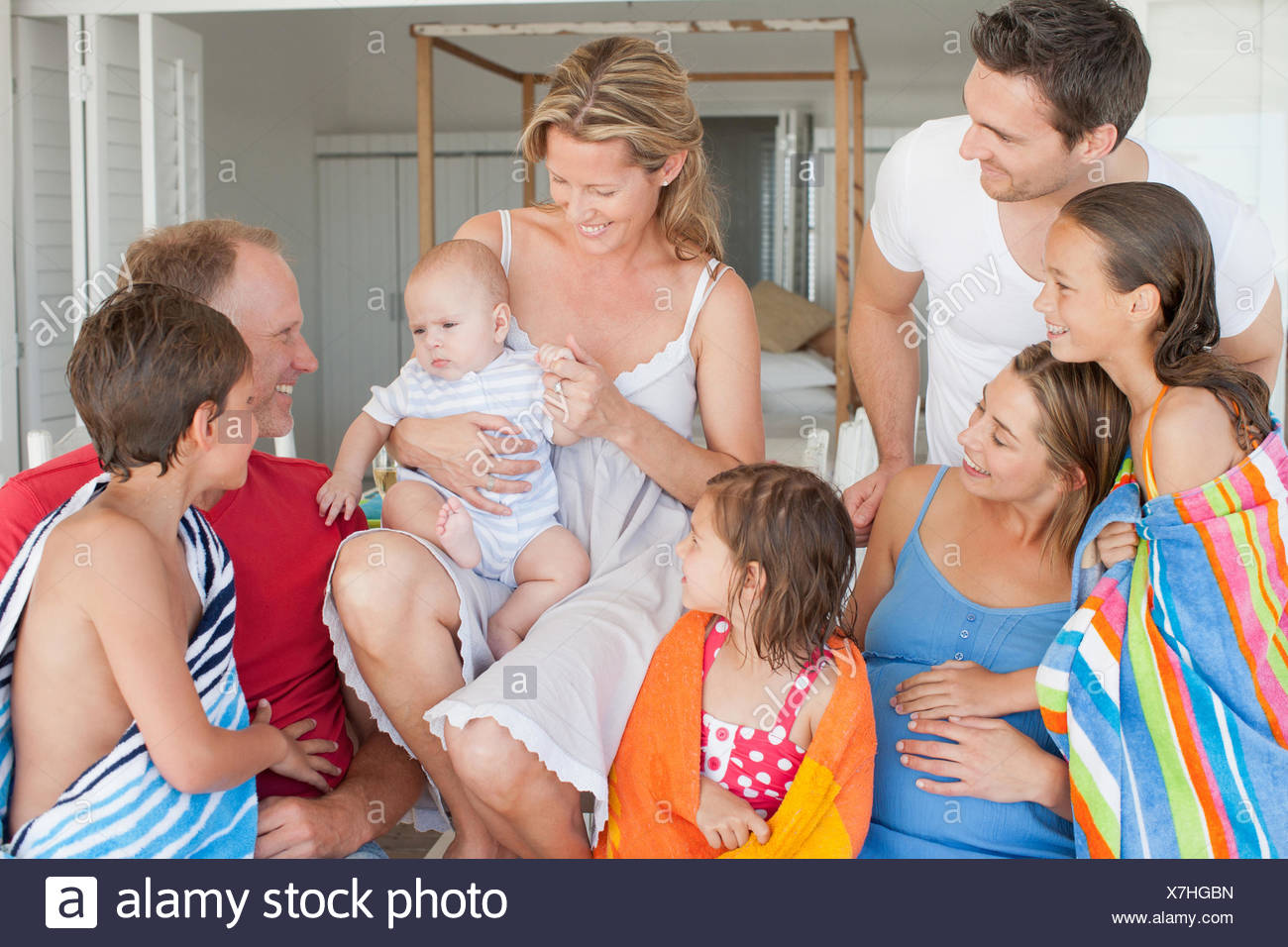 Family smiling after enjoying swimming - Stock Image