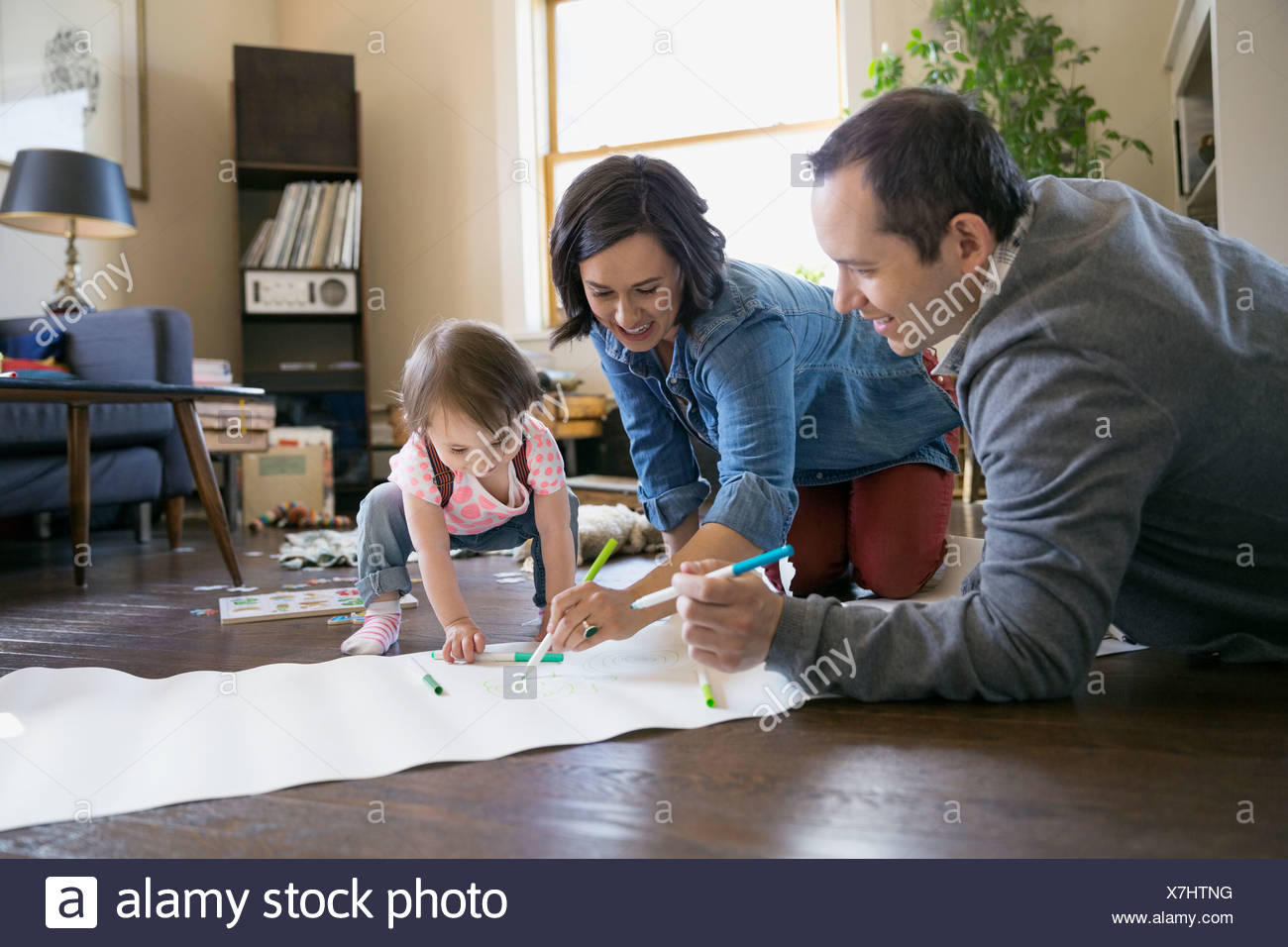 Young family drawing in living room Stock Photo