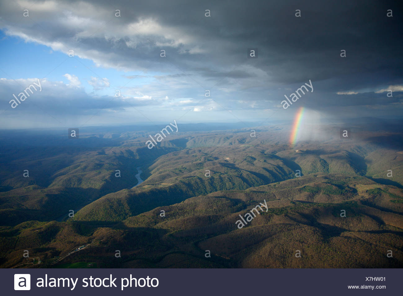 Aerial view of a rainbow appearing after a receding storm over the New River Gorge near Fayetteville, WV - Stock Image