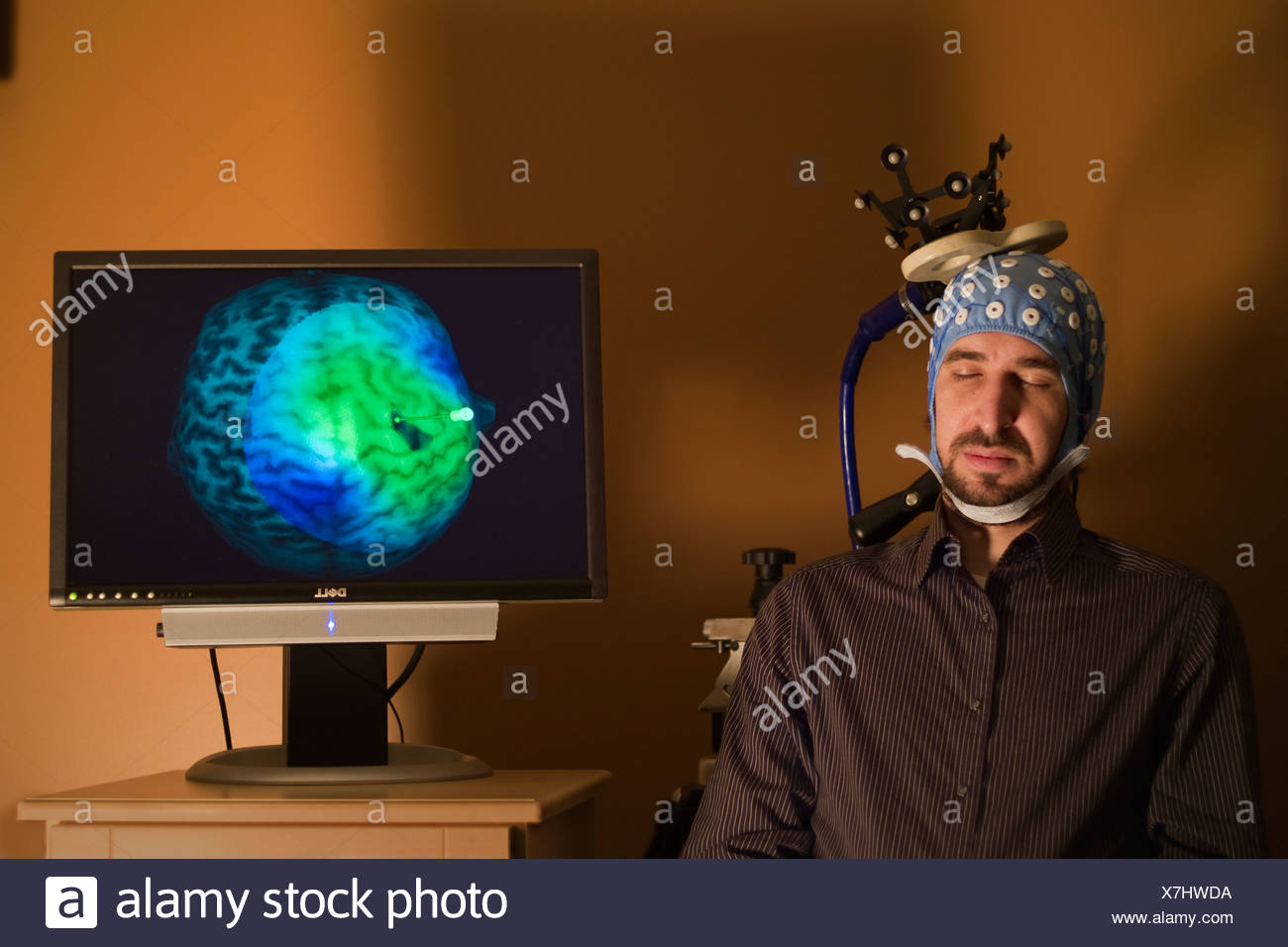 A device induces slow brain waves in sleeping patients. - Stock Image