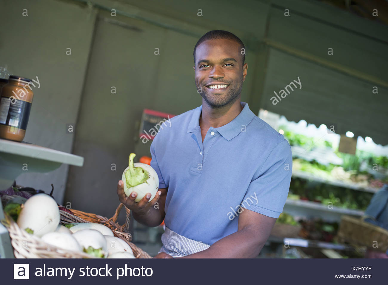 An organic fruit and vegetable farm. A man sorting vegetables. Stock Photo
