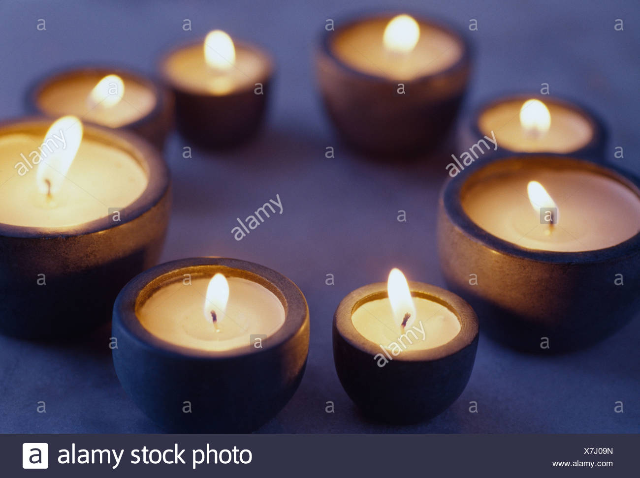 A circle of candles - Stock Image