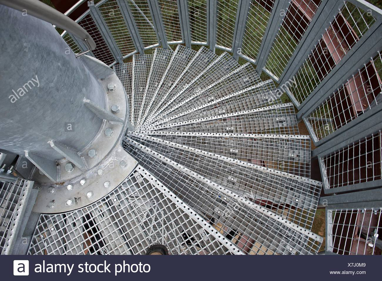 Personal perspective of a Metal spiral staircase - Stock Image