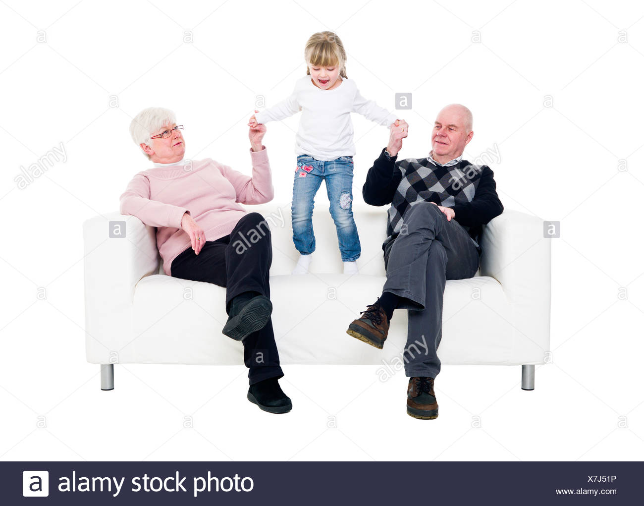 Little Girl with her grandparents - Stock Image