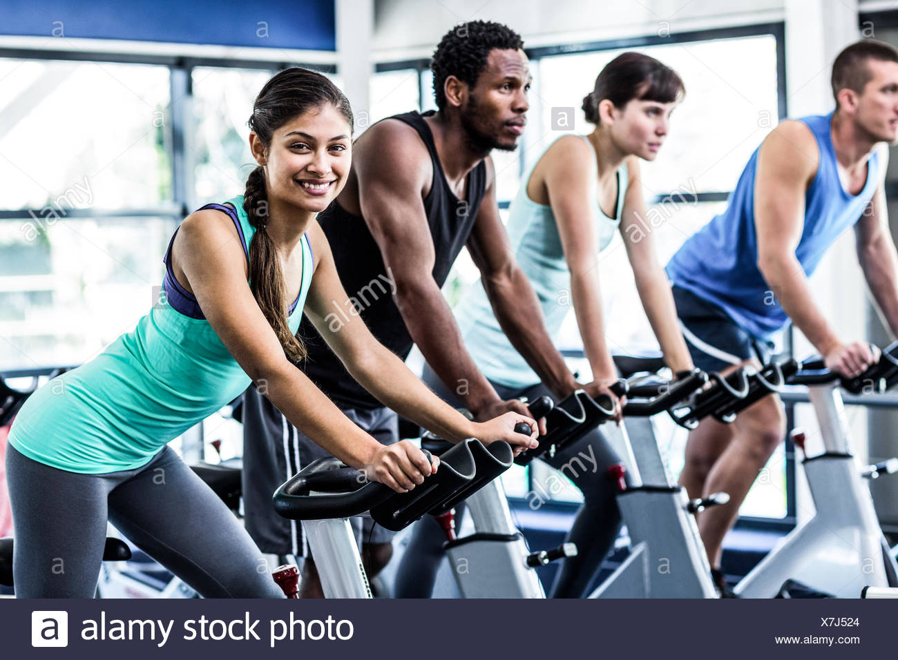 Fit people working out at spinning class - Stock Image