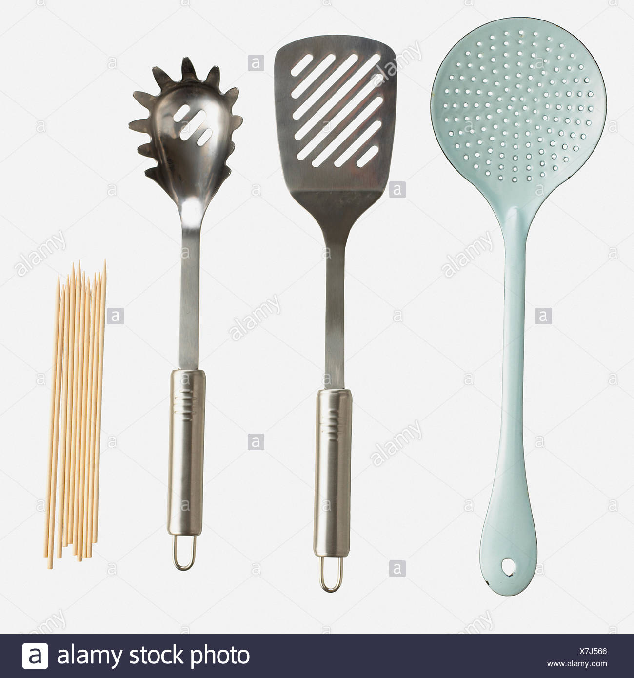 Slotted spoon, spatula, spaghetti claw and skewers Stock Photo