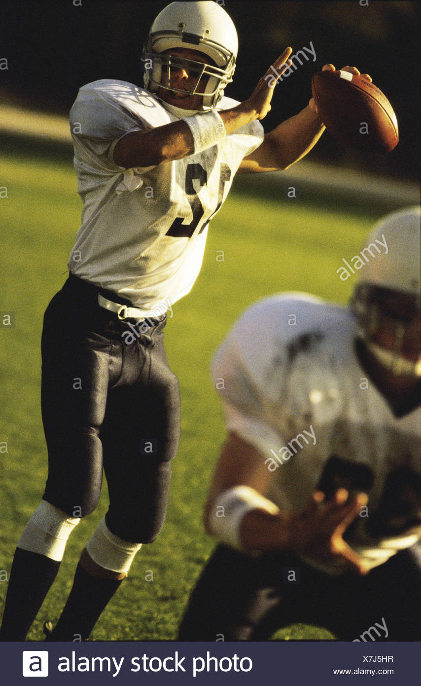 Football player passing the ball - Stock Image