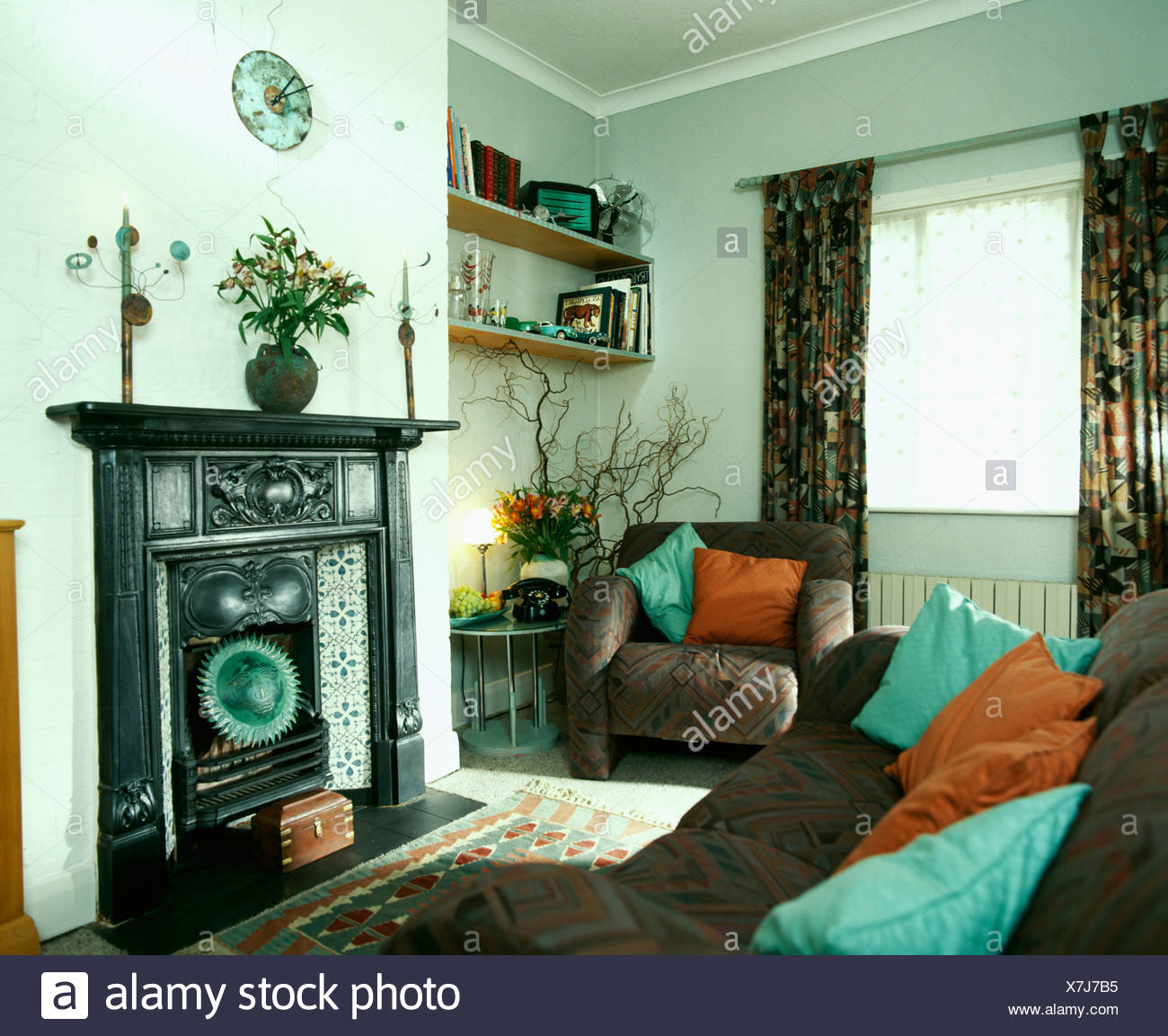 Turquoise And Orange Cushions On Brown Sofas In Front Of Sofas In