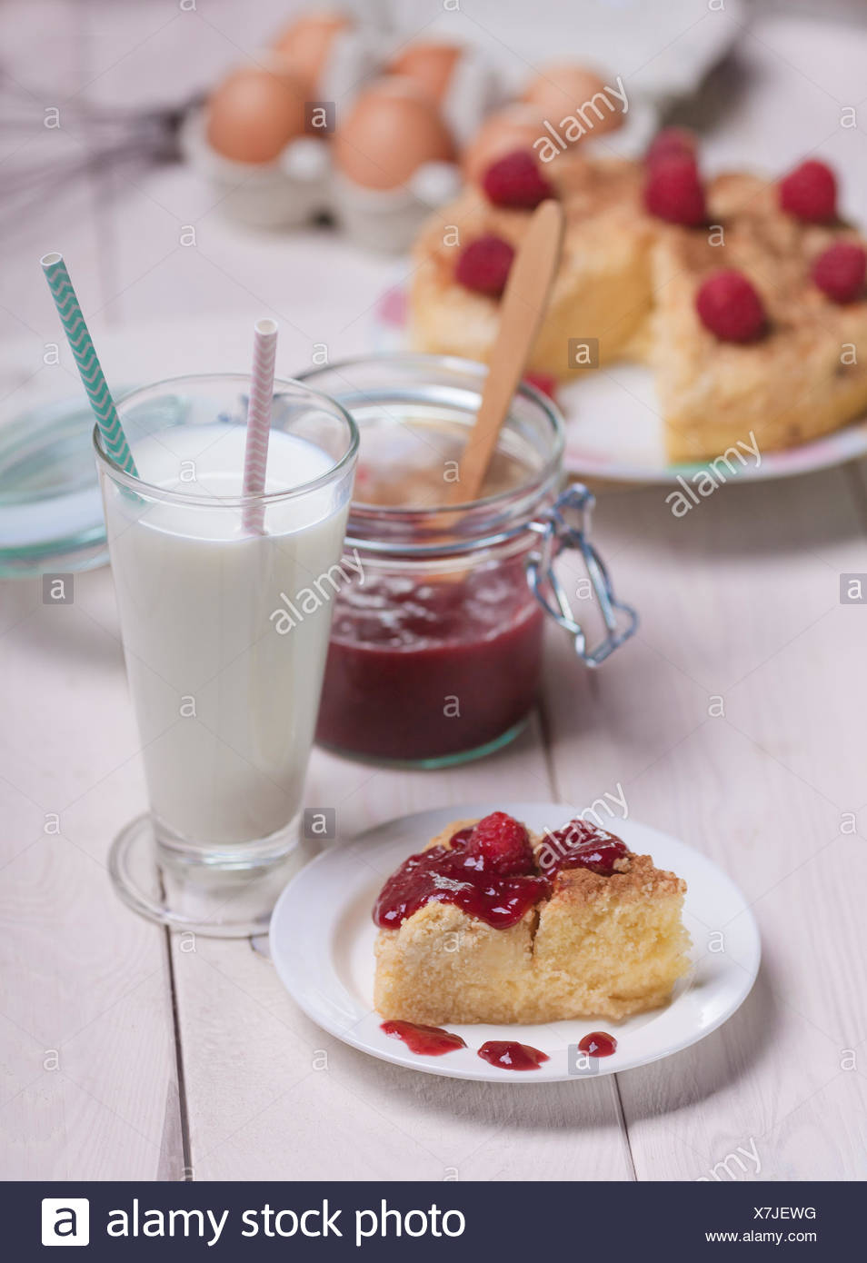 Sweet food with milk on rustic wooden planks. Debica, Poland - Stock Image