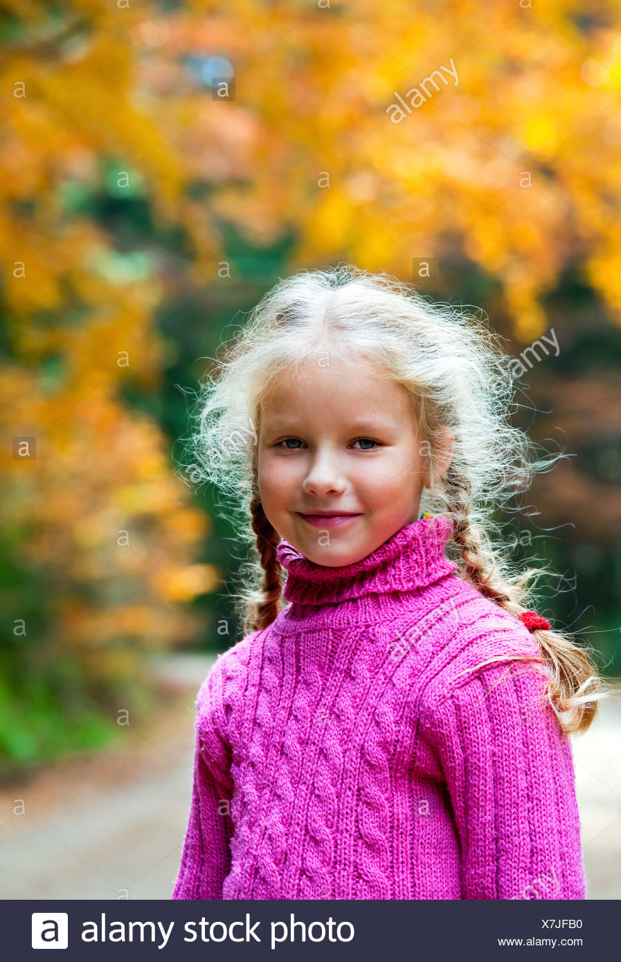 Schoolage girl autumn outdoor portrait - Stock Image