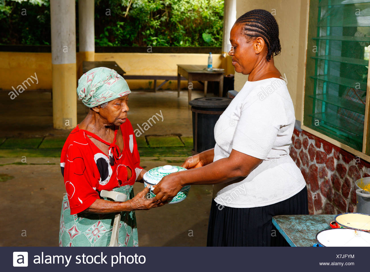 A sick woman gets food in the tuberculosis and leprosy station, Manyemen, Cameroon, Africa - Stock Image
