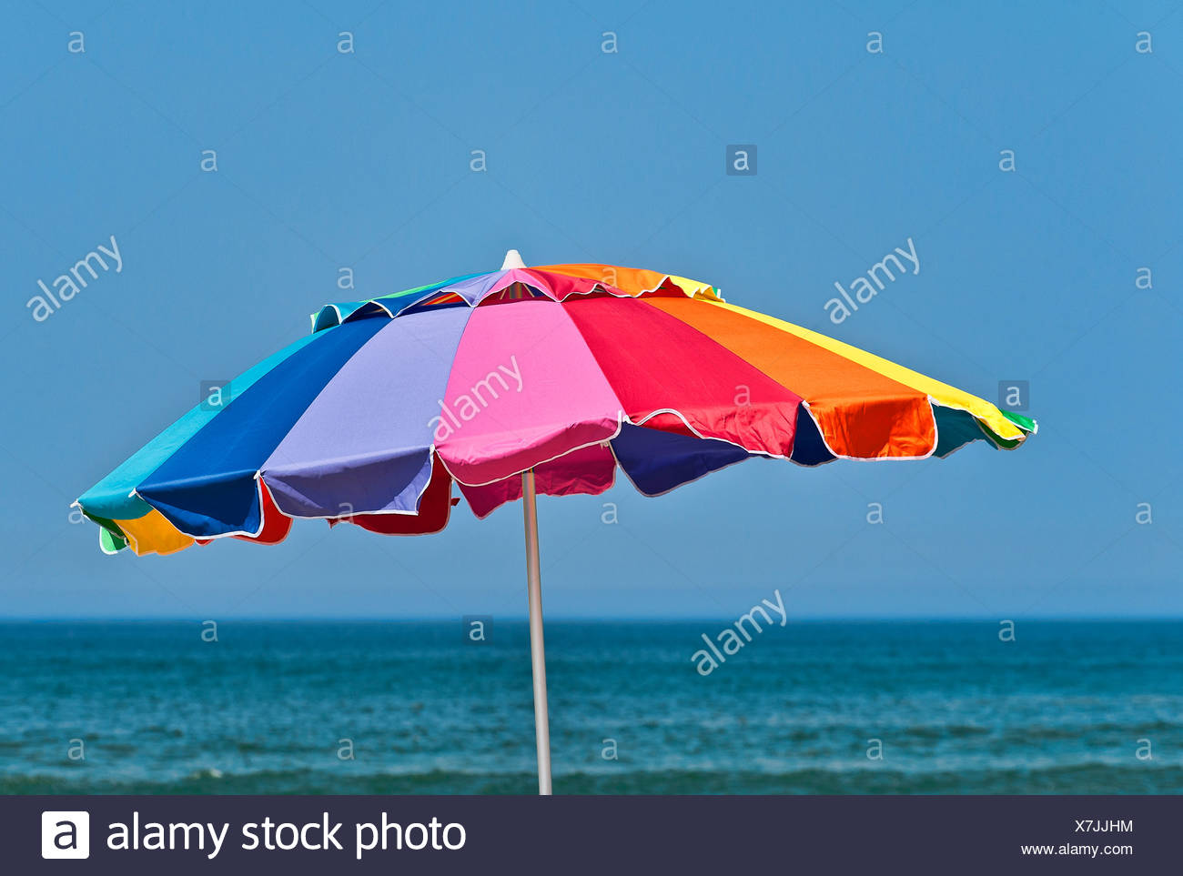 Colorful beach umbrella. - Stock Image