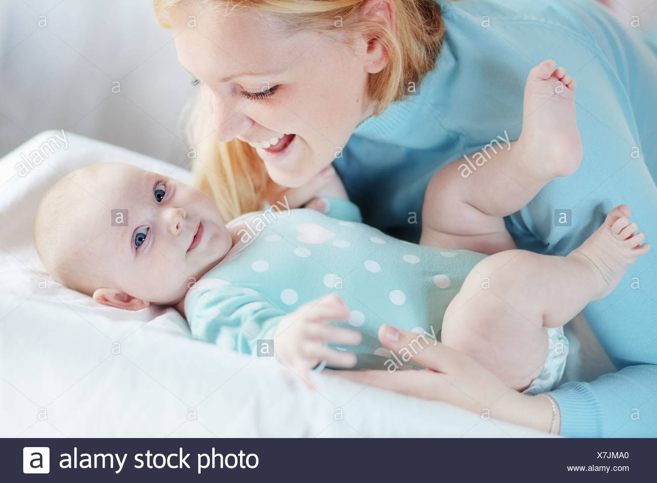 Portrait of a mother with her 4 months baby - Stock Image