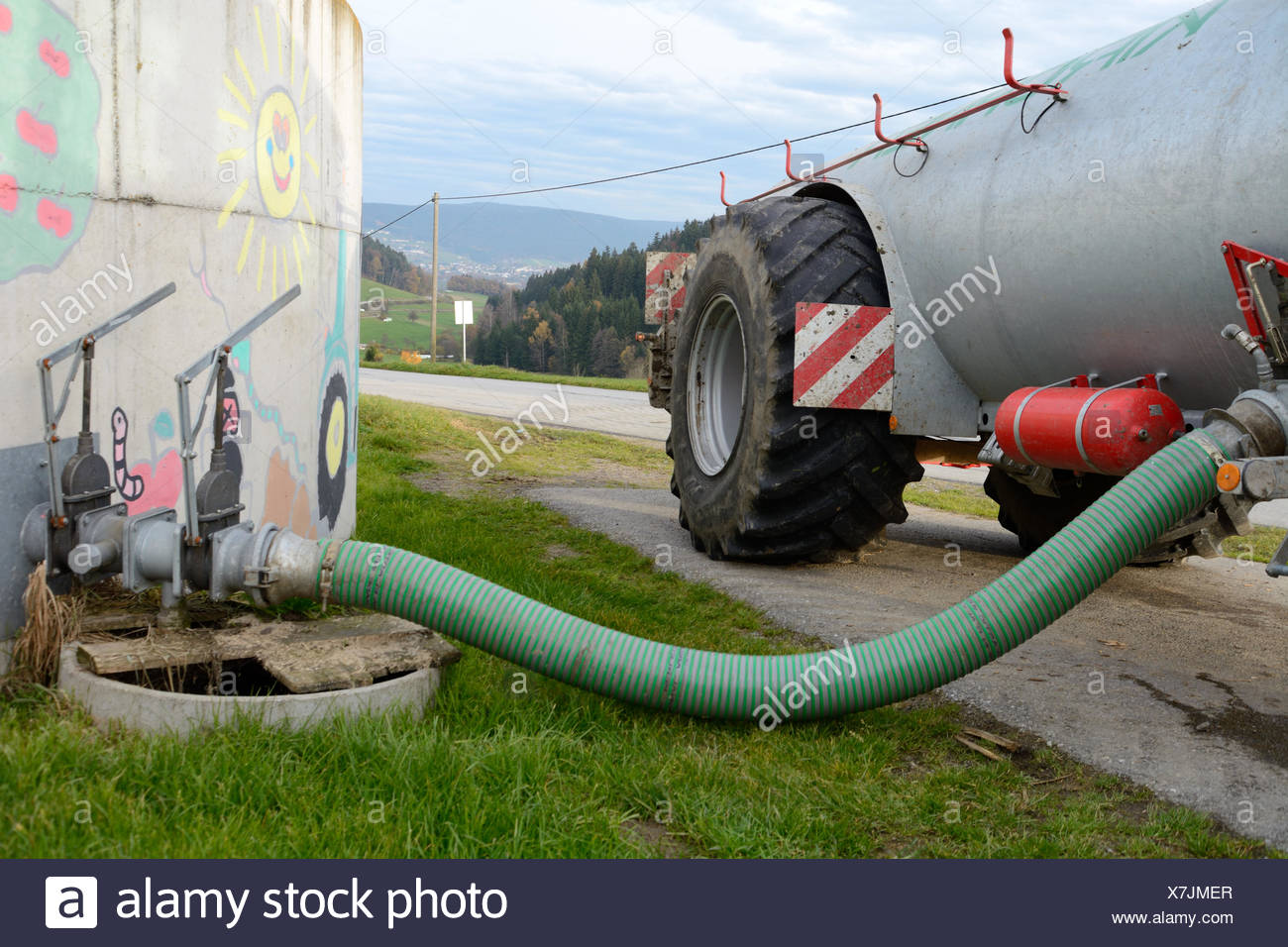 Slurry is filled in liquid manure spreader - Stock Image