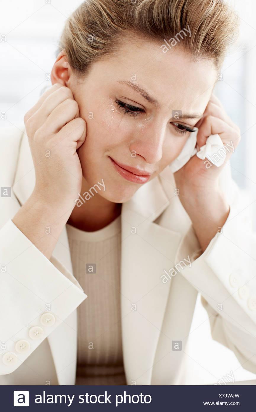 Businesswoman crying - Stock Image