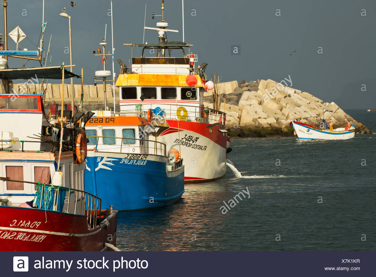 The waterfront at Vila Franca do Campo with fishing trawlers. - Stock Image