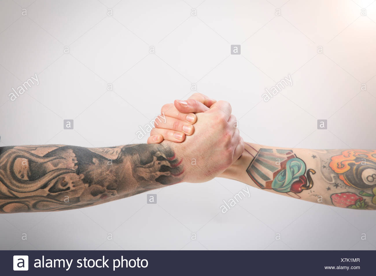 Two tattooed arms · Westend61 GmbH   Alamy Stock Photo 1584f4bacb84