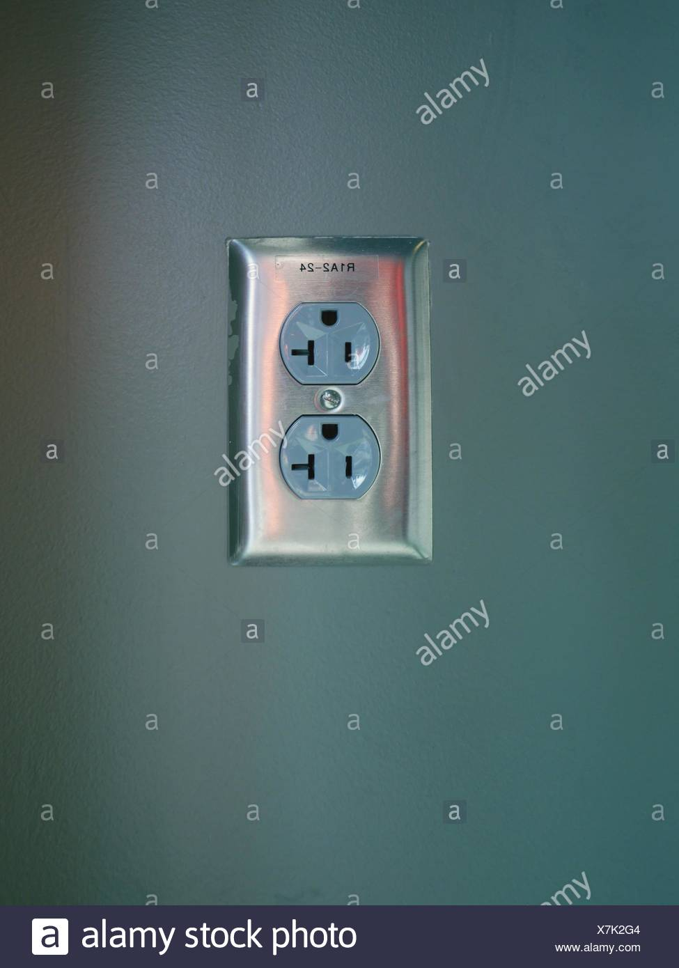 Close-Up Of Electric Sockets On The Wall Stock Photo
