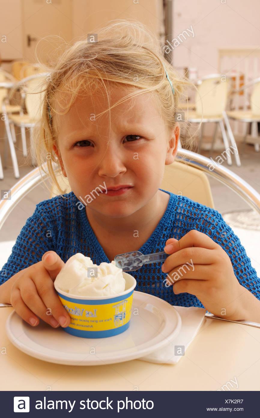 Little girl eating ice-cream - Stock Image