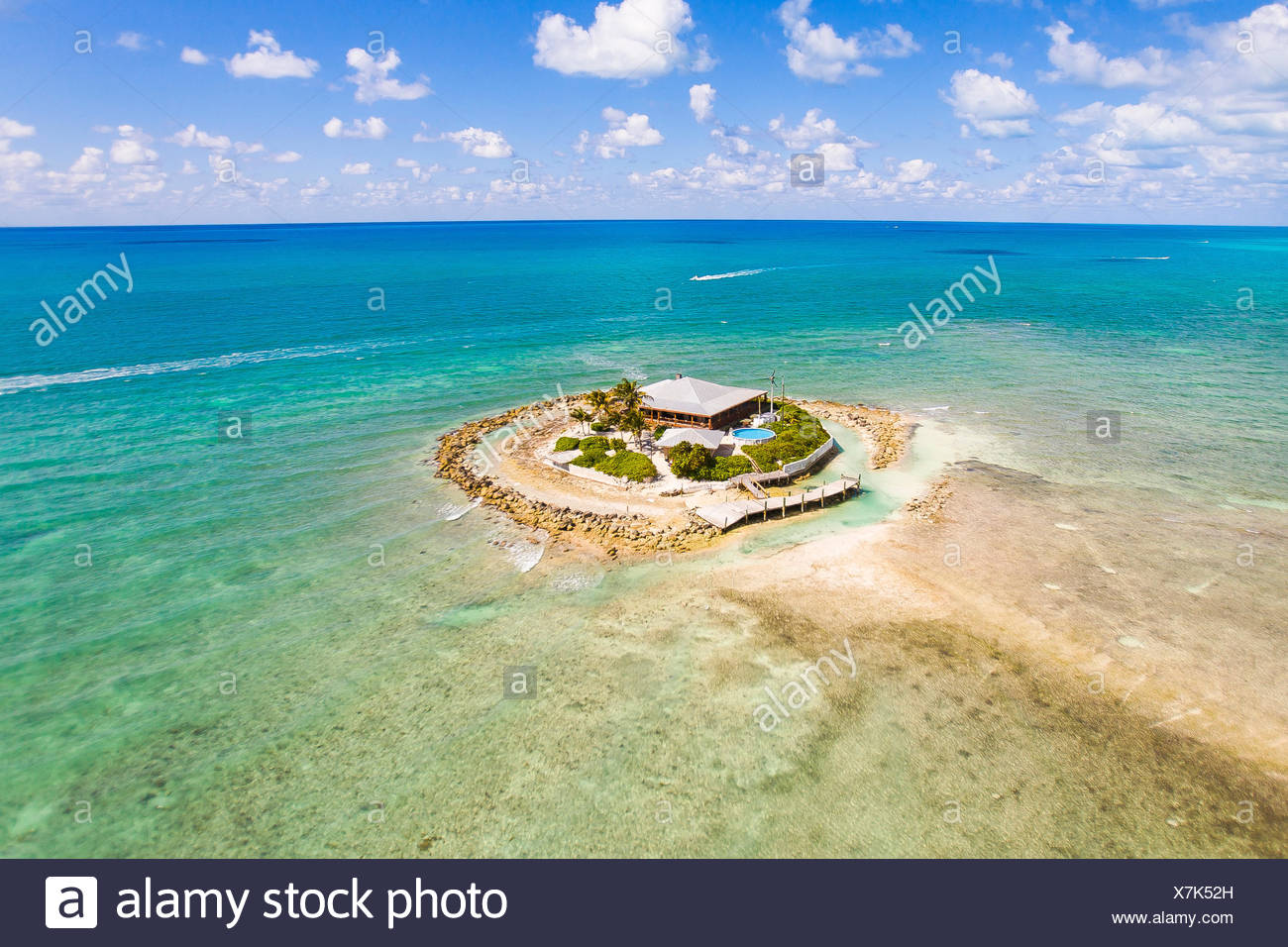 A single luxury home sits on a private island all alone off the Florida Keys during extreme low spring tide. - Stock Image