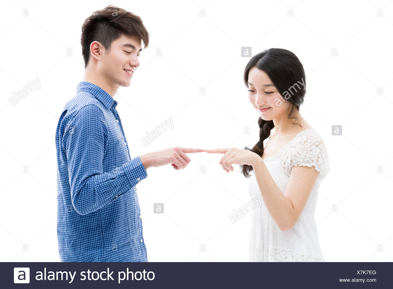 Happy young couple's fingers touching each other - Stock Image