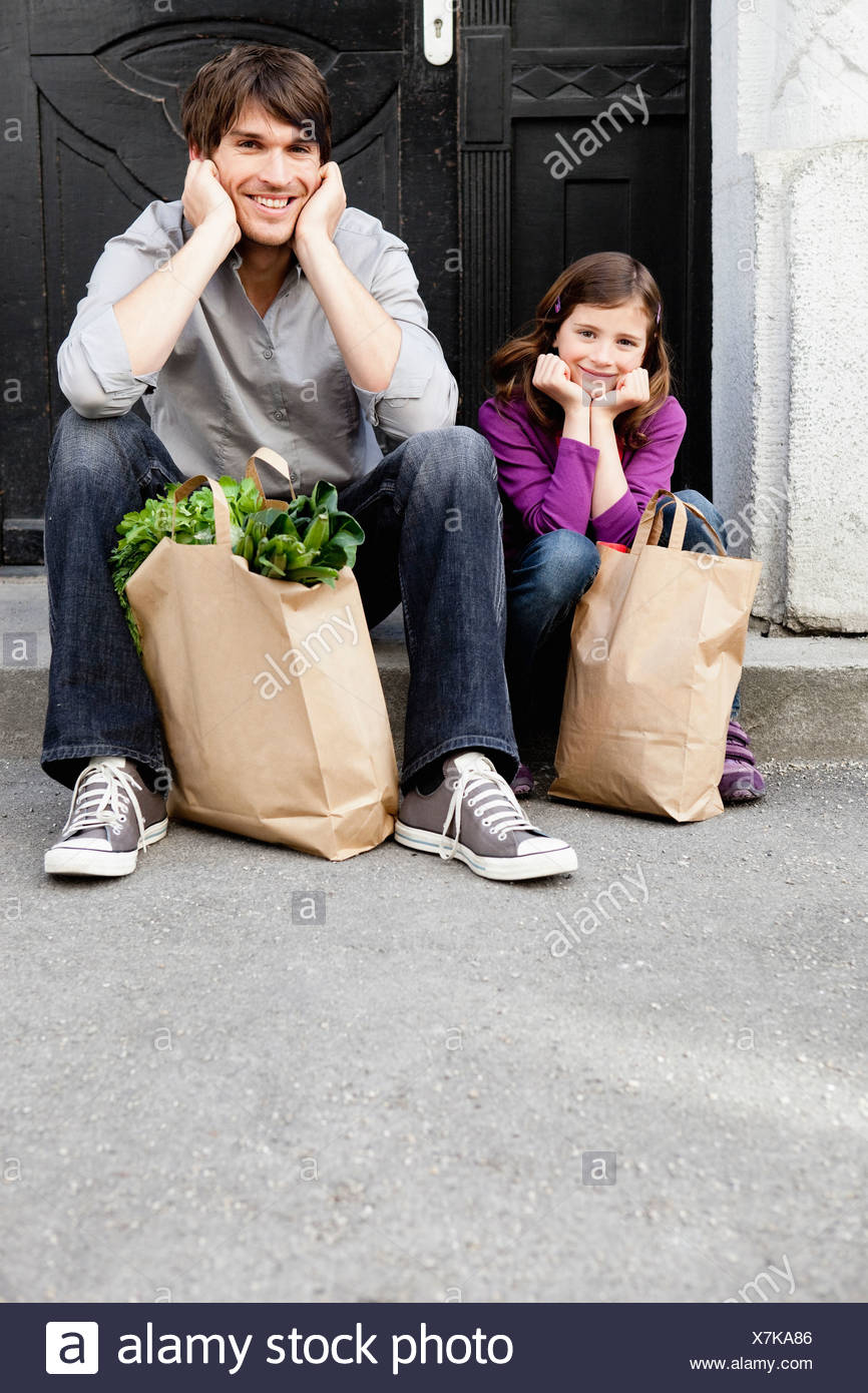 Father and girl shopping groceries - Stock Image