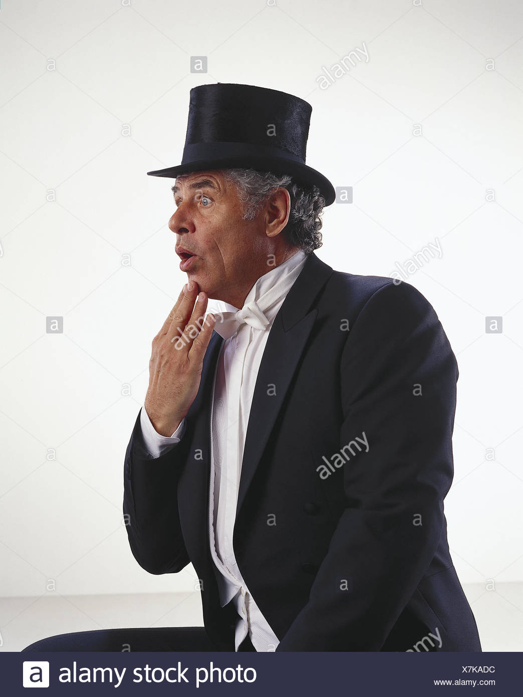 Man, tails, cylinder, amazes, gesture, half portrait, side view, senior, suit, headgear, top hat, elegantly, festively, facial play, surprises, there are astonished, taken aback, astonishment, bewilderment, surprise, preview, studio, cut outs, - Stock Image