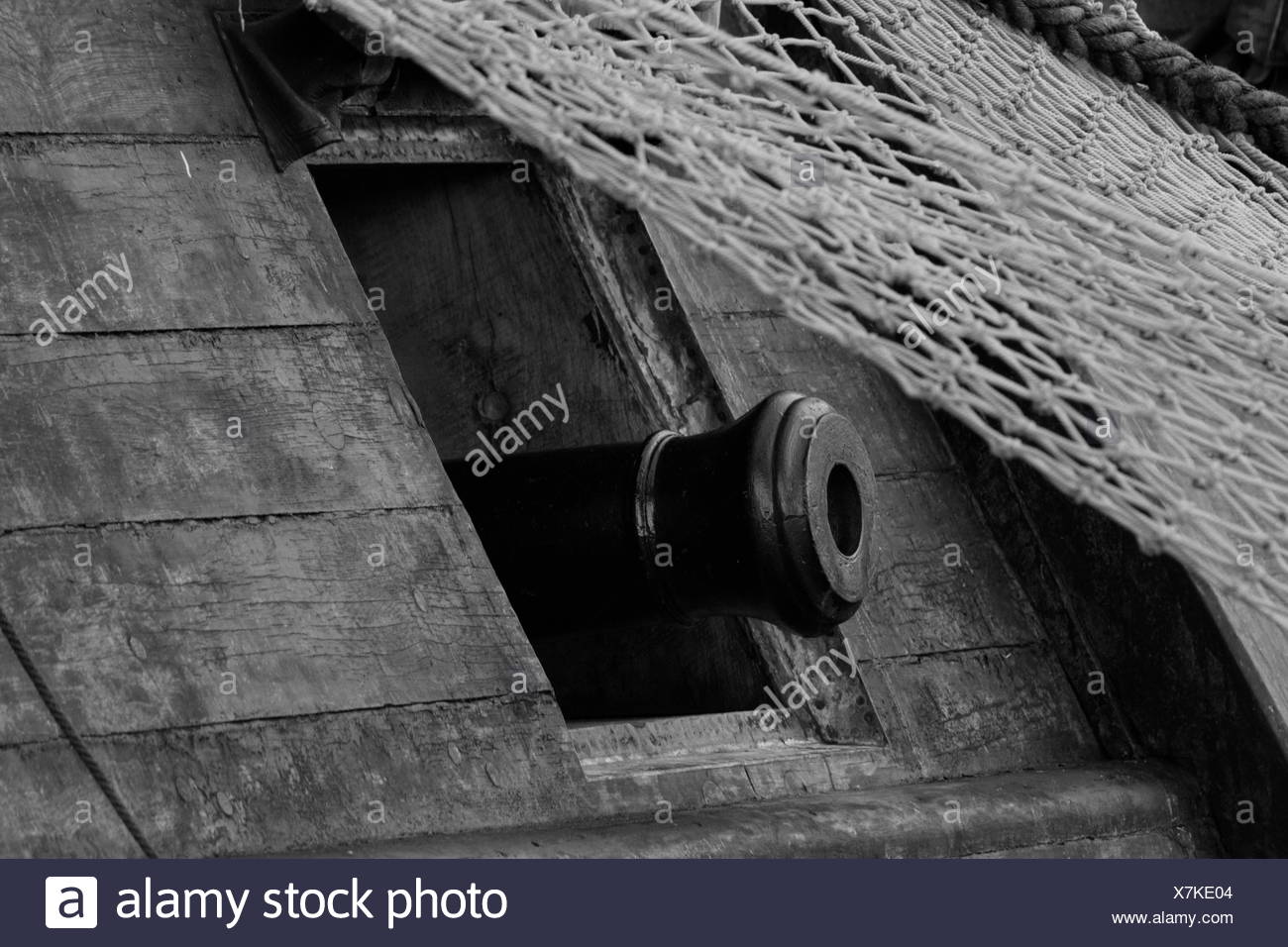 Salute cannon looking out of the porthole of a tall ship - Stock Image