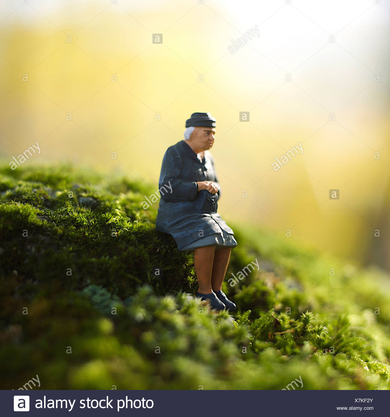 Solitary elderly female figure alone - Stock Image