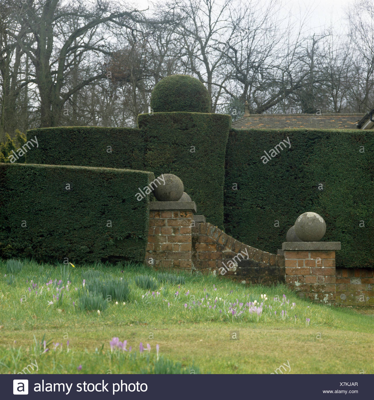 Stone balls stock photos stone balls stock images alamy stone balls on low wall in front of a tall well clipped hedge in a workwithnaturefo