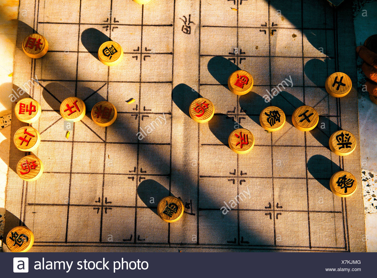 A Chinese table game played in parks usually by older men. - Stock Image