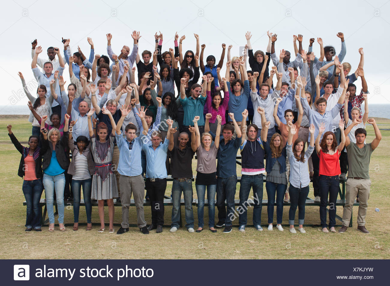 Group of spectators cheering - Stock Image