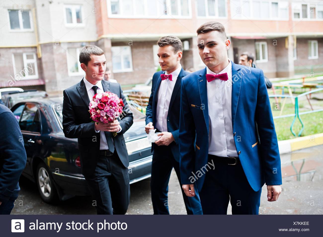 Groom with groomsman background wedding cars Stock Photo
