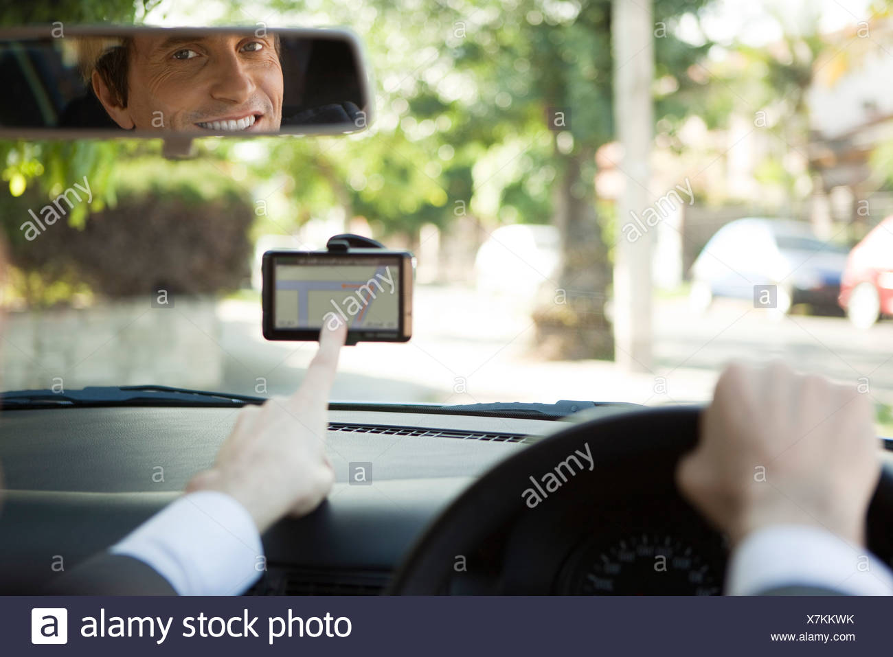 Driver using GPS for navigation assistance - Stock Image