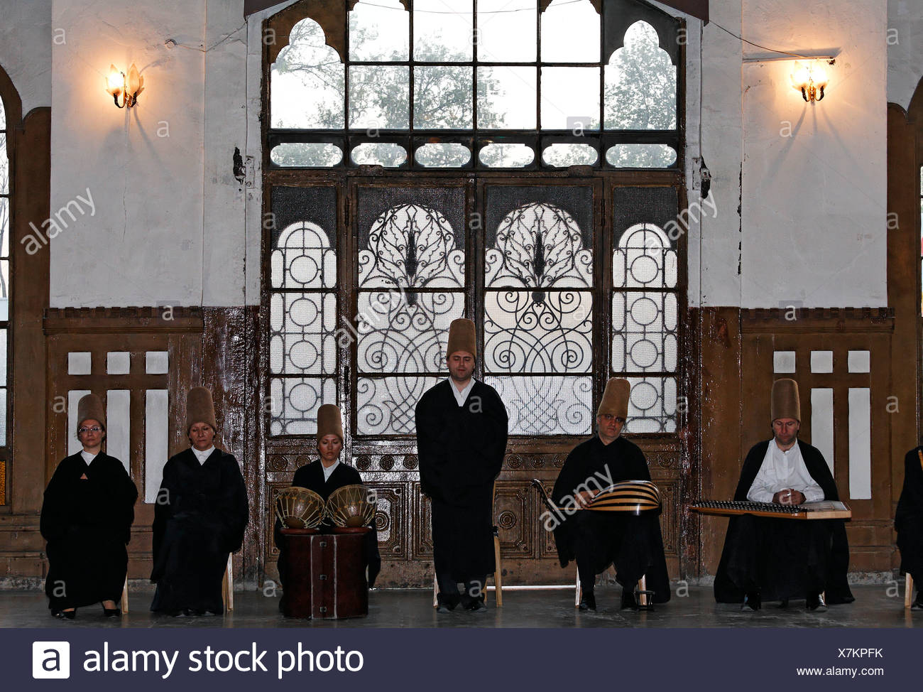 Sufi music group, Sema ceremony of the dancing dervishes of the order of Mevlevi, historic train station Sirkeci, Istanbul, Tur Stock Photo