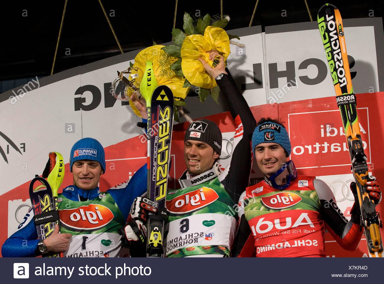Flower ceremonie, Mario Matt, Jean-Baptist Grange (L), Manfred Moelgg (R), FIS Ski Worldcup, Slalom men, Schladming, 2008, Nigh - Stock Image