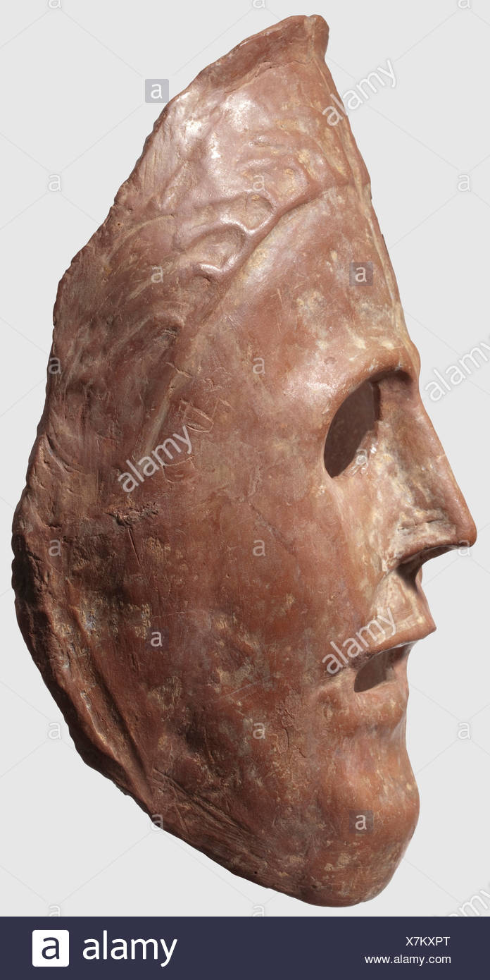 A Greek theatre mask, 6th/5th century B.C. Reddish ceramic. Semicircular, naturalistically modelled mask with openings for the eyes, mouth and nose, stylised hair on the forehead. Remains of lime sintering, small chipping above the forehead on the right. Height 24 cm. Provenance: from an old Bochum collection, historic, historical, ancient world, ancient world, ancient times, object, objects, stills, clipping, cut out, cut-out, cut-outs, mediterranean, precious metal, precious metals, mask, masks, Additional-Rights-Clearences-NA - Stock Image