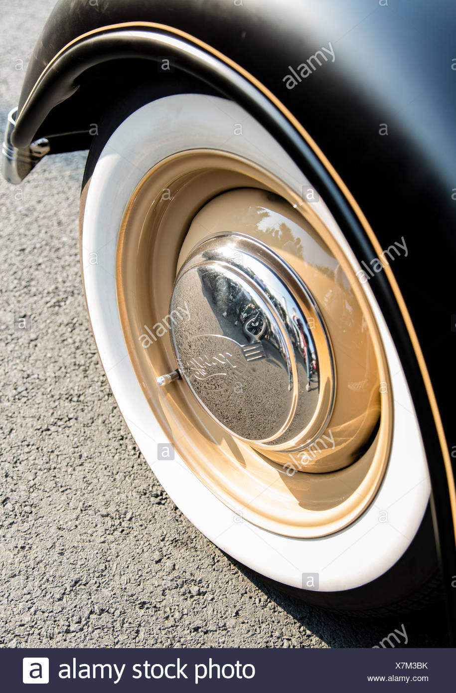 Whitewall tire of a custom Ford car at the Wheels and Waves custom motorbike festival in Biarritz, France. - Stock Image