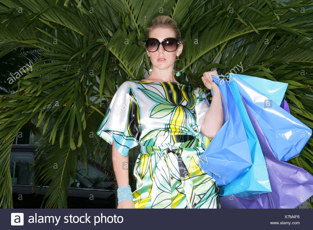 Fashionable woman with shopping bags. - Stock Image