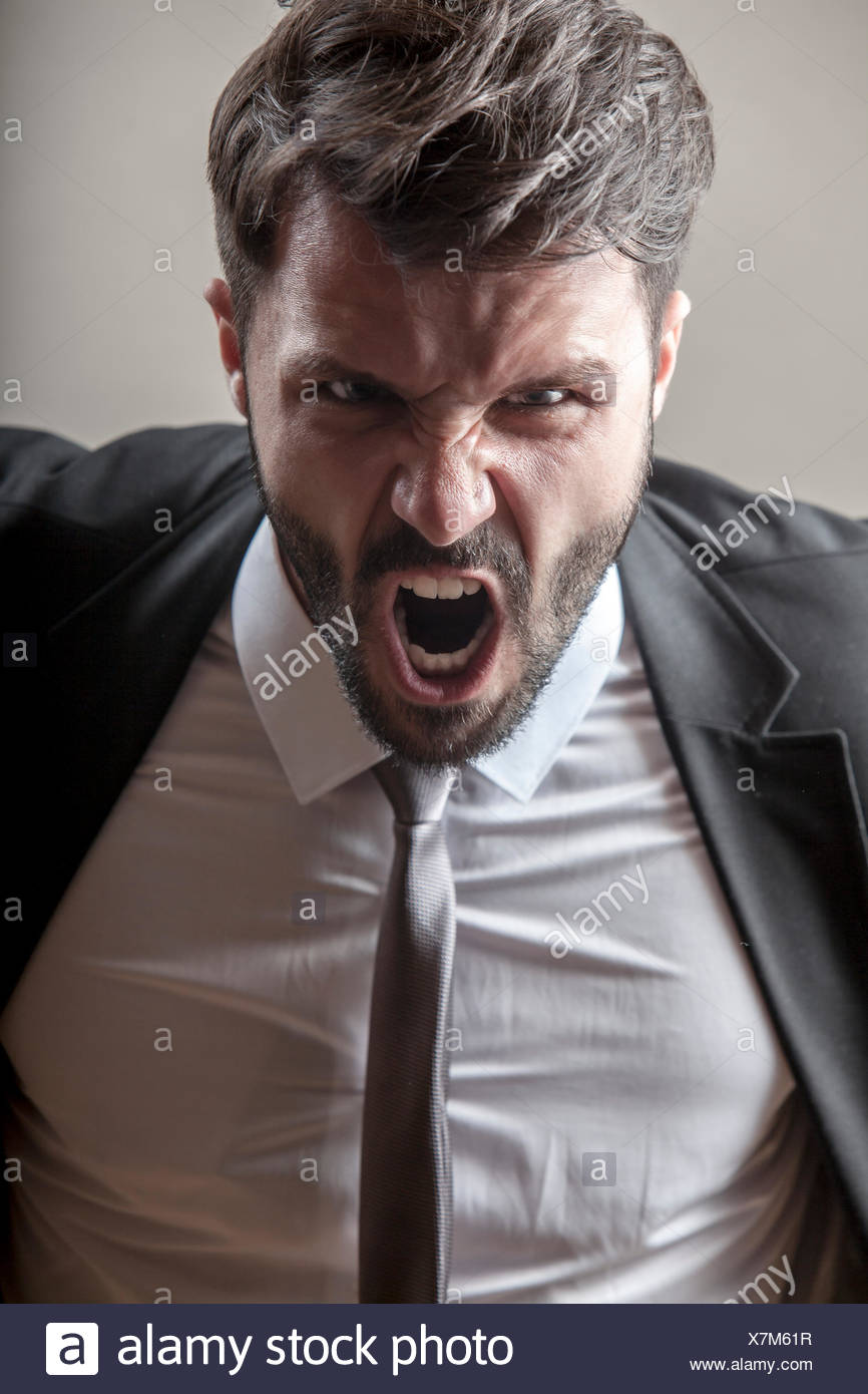 Portrait of businessman screaming - Stock Image