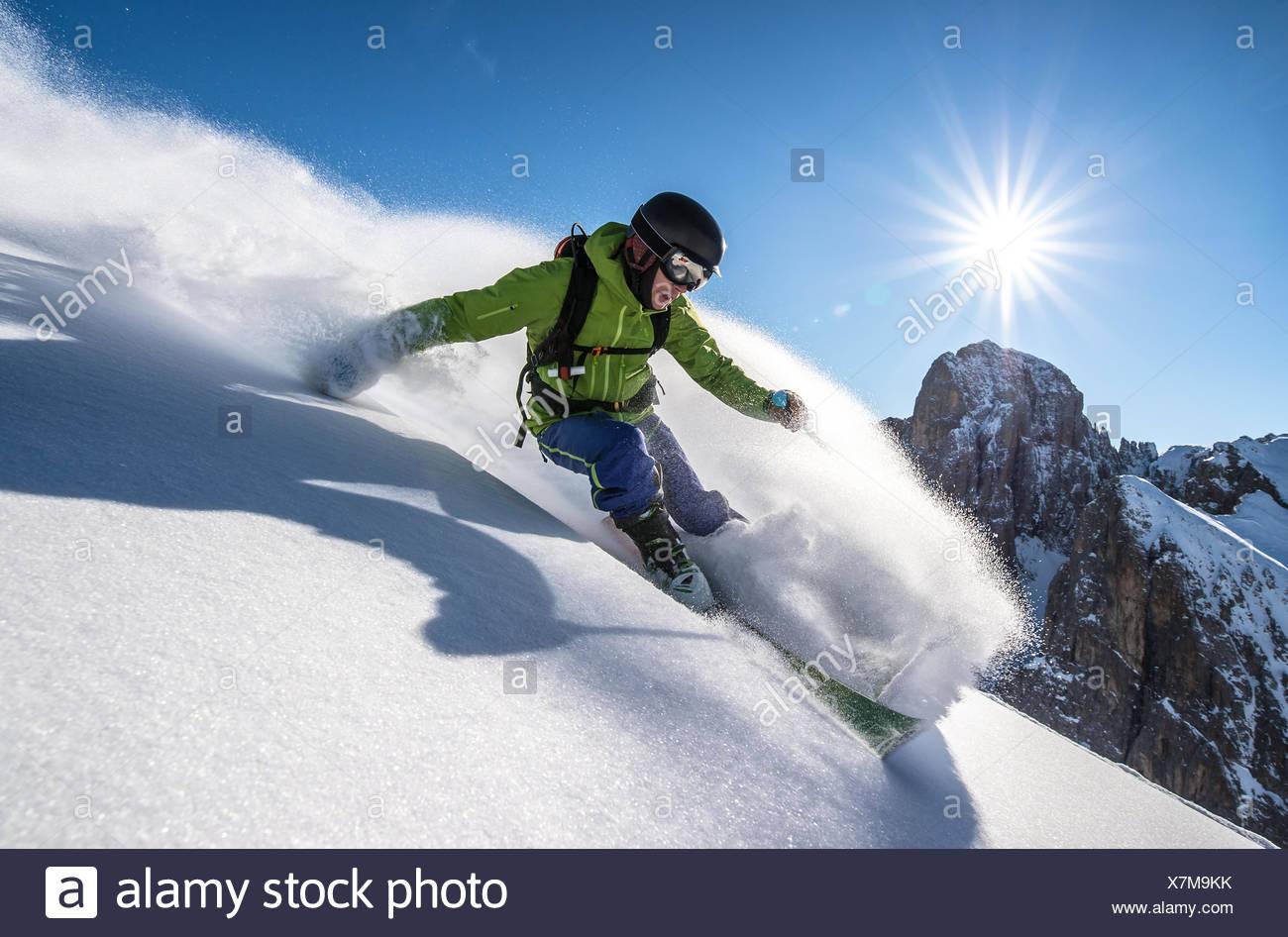 Man skiing off piste, Dolomites, Italy - Stock Image