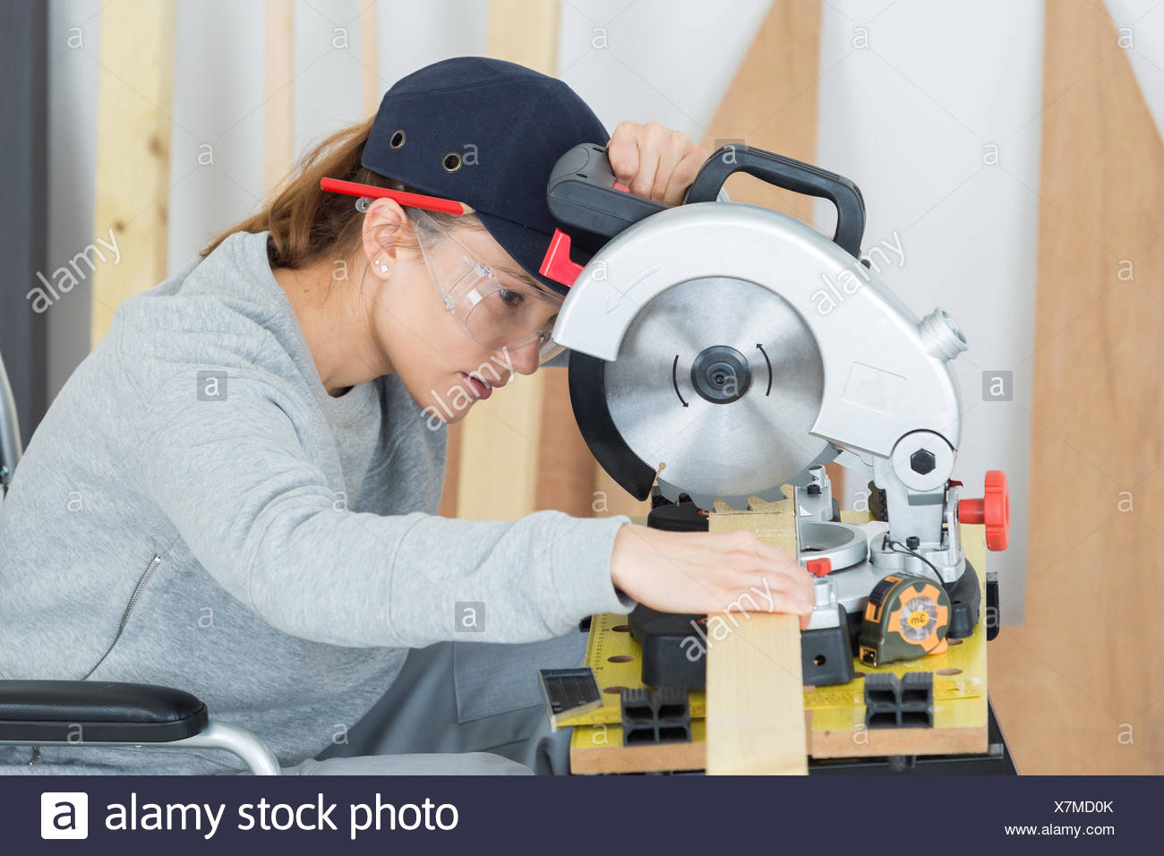 young woman in carpentry professional training - Stock Image